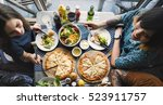 friends eating pizza party... | Shutterstock . vector #523911757