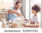 father and son are smiling... | Shutterstock . vector #523947253