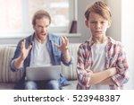 sad little boy is looking at... | Shutterstock . vector #523948387