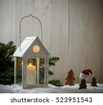 Lantern As House In Snow With...