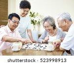 two senior asian men playing... | Shutterstock . vector #523998913