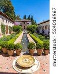 Small photo of GRANADA, SPAIN - JUNE 14, 2016: Patio de la Acequia, Fountain and gardens in Alhambra palace in Granada, Spain on June 14, 2016