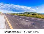 asphalt road amongs green...   Shutterstock . vector #524044243