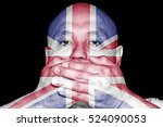 A Man Covering His Mouth With...
