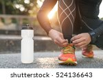 man tying jogging shoes.a... | Shutterstock . vector #524136643