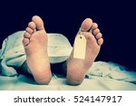 Stock photo the dead man s body with blank tag on feet under white cloth in a morgue retro style 524147917