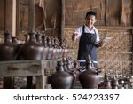 portrait of male potter using... | Shutterstock . vector #524223397
