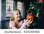 happy girl decorates the... | Shutterstock . vector #524250583
