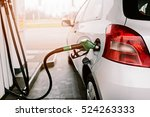 Small Silver Car Refuelling At...