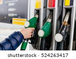 woman holding a fuel nozzle on