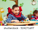 cheerful boy with disability at ... | Shutterstock . vector #524271697