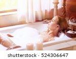 beautiful woman lying down in...   Shutterstock . vector #524306647