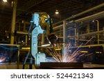 robot is welding assembly... | Shutterstock . vector #524421343