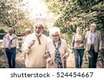 group of old people walking... | Shutterstock . vector #524454667