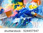closeup of brush and palette. | Shutterstock . vector #524457547