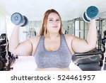 portrait of obese woman lifting ... | Shutterstock . vector #524461957
