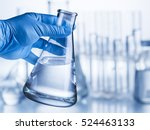 Laboratory Beaker In Analyst's...