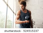 fitness man with dumbbell in... | Shutterstock . vector #524515237