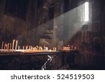 Small photo of Old Armenian christian church interior with sun rays from the window falling on the candles. Religion, old architecture, christianity, travel, belief concept.