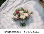 the bride's bouquet lying on a... | Shutterstock . vector #524725663