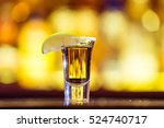 gold tequila in a glass on a... | Shutterstock . vector #524740717