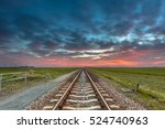 Disappearing railroad on the horizon under a blue and red sky as a concept for future successfullness.