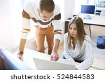 Small photo of Two business partners accounting data information about success of corporation using laptop,internet connection while sitting in workshop with blank screen computer for your advertising on background