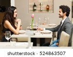 cheerful couple in a restaurant  | Shutterstock . vector #524863507