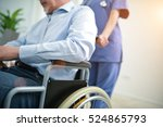 nurse pushing a wheelchair | Shutterstock . vector #524865793