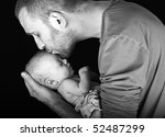 A Loving Father Kisses His...