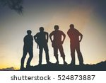 Silhouette Of Friends Standing...