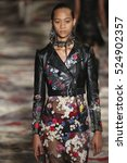 Small photo of PARIS, FRANCE - OCTOBER 3: A model walks the runway during the Alexander McQueen designed by Sarah Burton show as part of the Paris FW Womenswear Spring/Summer 2017 on October 3, 2016 in Paris, France