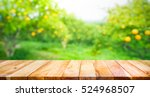 Wood Table Top With Blur Of...
