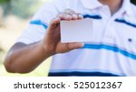man holding white business card. | Shutterstock . vector #525012367