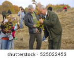 "Small photo of Tigveni, Romania - November 05, 2011: ""Plantam fapte bune"" forest planting event, organized by Geea group of ecologists with support of Romsilva, romanian gendarmerie and hundreds of volunteers."