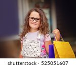 cute little girl with shopping... | Shutterstock . vector #525051607