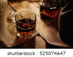 glass of whiskey and hat  | Shutterstock . vector #525074647