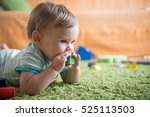 sweet baby girl putting a toy... | Shutterstock . vector #525113503