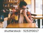 sick student blowing his nose... | Shutterstock . vector #525293017