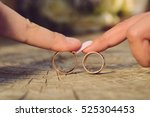 newlyweds playing with wedding... | Shutterstock . vector #525304453