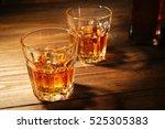 glasses of whisky on wooden... | Shutterstock . vector #525305383