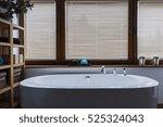 elegant oval bathtub in a... | Shutterstock . vector #525324043