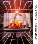 chef prepares roast chicken in... | Shutterstock . vector #525325723