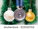 Small photo of Medical stethoscope membrane anteriorly with two tubes surrounded by Christmas tree balls on blurred background with adornment. Concept card for Christmas and New Year in medicine