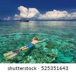 man snorkeling in clear... | Shutterstock . vector #525351643