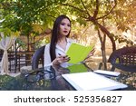 beautiful young asian holding a ... | Shutterstock . vector #525356827