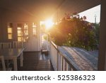 flowers hang on porch. house...   Shutterstock . vector #525386323