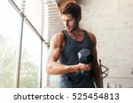 fitness man with dumbbell in... | Shutterstock . vector #525454813