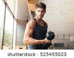 fitness man stands sideways in... | Shutterstock . vector #525455023