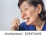 asian elderly woman with a... | Shutterstock . vector #525471643